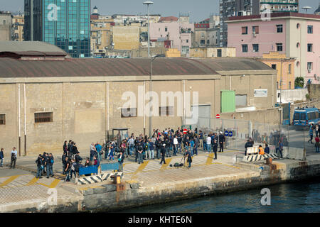 The 'NO G7' protest group at the port of Naples, ready to embark for Ischia, where the G7 Meeting of Interior Ministers - Stock Photo
