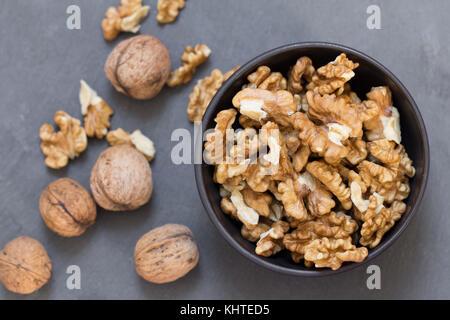 wallnuts composition on black slate background - Stock Photo