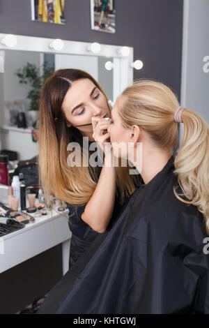 makeup artist doing eye make up - Stock Photo