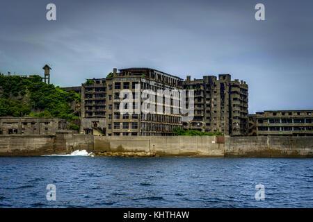Nagasaki, Hashima, Japan - October 2017: Ghost town on an abandoned island called Gunkanjima and also Hashima near - Stock Photo
