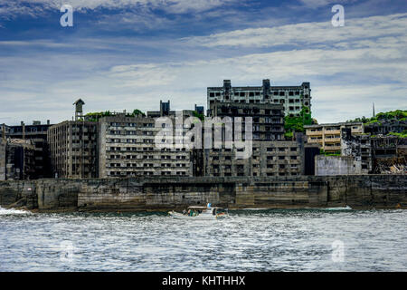 Nagasaki, Hashima, Japan - October 2017: Ghost town on an abandoned island called Gunkanjima and also Hashima near - Stock Photo