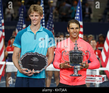 Spanish tennis player Rafael Nadal and runner up Kevin Anderson holding their  US Open 2017 trophies ,New York City, - Stock Photo
