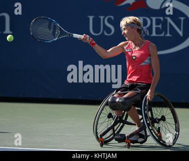 German tennis player Sabine Ellerbrock plays a forehand shot in Wheelchair Singles match at US Open 2017 Tennis - Stock Photo