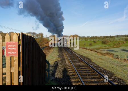 Steam train departing from burrs country park railway station bury lancashire uk - Stock Photo