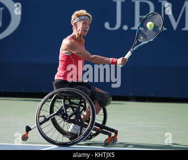 German tennis player Sabine Ellerbrock plays a backhand shot in Wheelchair Singles match at US Open 2017 Tennis - Stock Photo