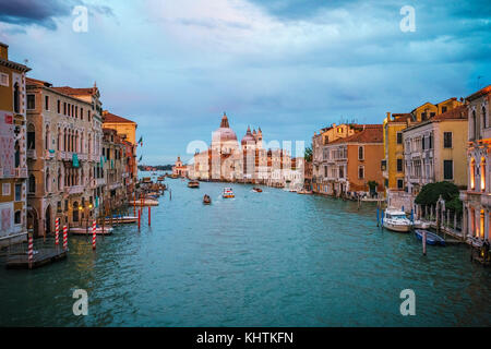 View from the Ponte dell'Accademia on boats and gondolas on the grand canal in venice on a cloudy day during glowing - Stock Photo