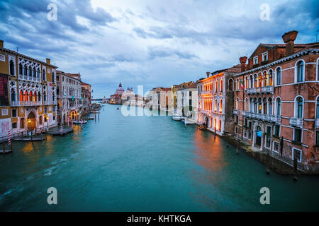 View from the Ponte dell'Accademia on boats and gondolas on the grand canal in venice on a cloudy day in the blue - Stock Photo