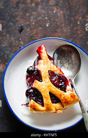 Lattice autumn fruit pie, with blackcurrant, blackberry, cherry compote in puff pastry pie - Stock Photo
