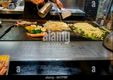 Kyoto Japan - October 2017 - Chef making Okonomiyaki in Kyoto Japan - Stock Photo