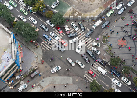 Heavy traffic in a small streets crossroads vertical view - Stock Photo