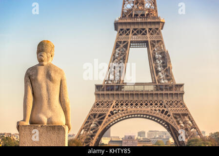 Woman stone statue in the Trocadero garden, Eiffel tower in the background, Paris France - Stock Photo