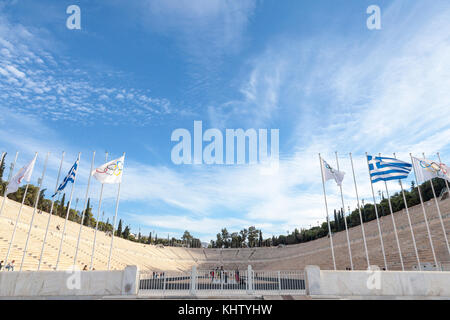 ATHENS, GREECE - NOVEMBER 4, 2017:  Entrance to the Panathenaic Stadium, with the Olympic flag and the Greek flag - Stock Photo
