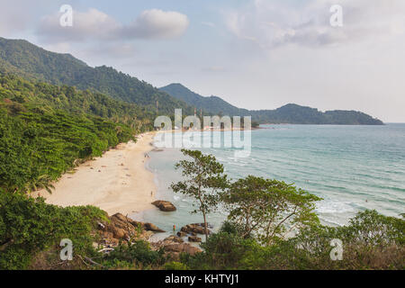 Lonely beach on Koh Chang island during sunset in Thailand - Stock Photo