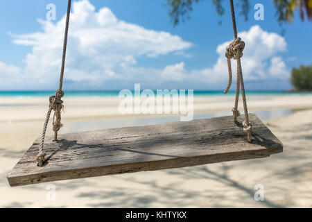 Wooden swing hanging on the beach on Koh Kood island in Thailand. - Stock Photo