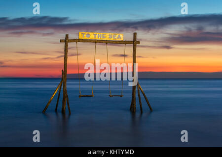 Wooden swing on the beach of Koh Kood island in Thailand. - Stock Photo