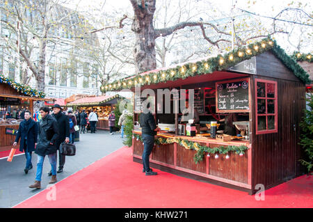 French raclette stall at Christmas in Leicester Square festival, Leicester Square, West End, City of Westminster, - Stock Photo