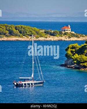 Island of Vis bay entrance and lighthouse view, sailing destination in Dalmatia archipelago of Croatia - Stock Photo
