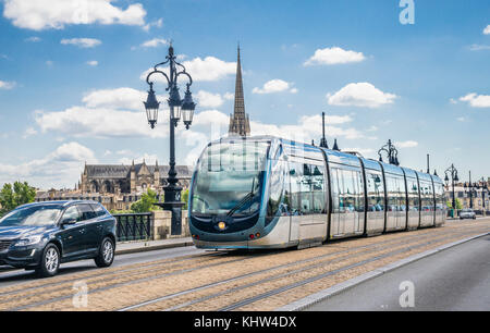 France, Gironde department, Bordeaux, a modern tram of the Bordeaux tramway network is crossing the Pont-de-Pierre - Stock Photo