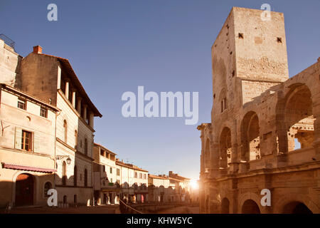 View of street and Arles Amphitheatre, Arles, Provence-Alpes-Cote d'Azur, France - Stock Photo