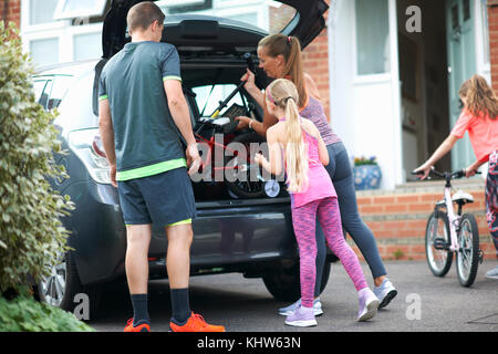 Family packing car for holiday - Stock Photo