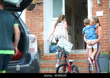 Family unpacking car after holiday - Stock Photo