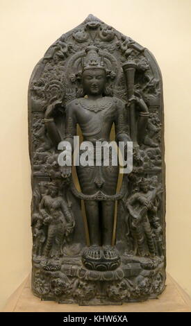 Stone statue depicting Vishnu, one of the principal deities of Hinduism, God of Protection, God of the Preservation - Stock Photo