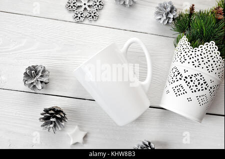 Mockup white cup on a wooden background, in Christmas decorations. The top view is photographed - Stock Photo