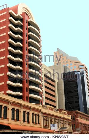 Old and new architecture. Modern skyscrapers built behind historic buildings - Stock Photo