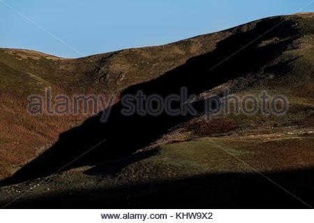 Yetholm, Kelso, Scottish Borders, UK. 19th Nov, 2017. The morning sun casts light over Cheviot White Law (410m), - Stock Photo