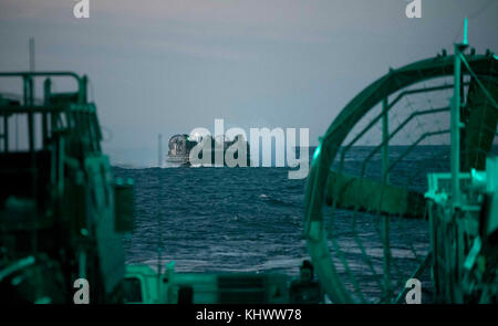 ATLANTIC OCEAN (Nov. 16, 2017) A landing craft, air cushion prepares to enter the well deck of the amphibious transport - Stock Photo