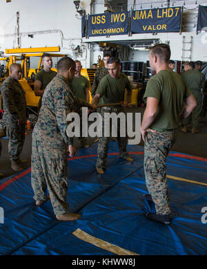 ATLANTIC OCEAN (Nov. 16, 2017) Marines assigned to Battalion Landing Team 26E Company practice basic self-defense in the hangar bay of the amphibious assault ship USS Iwo Jima (LHD 7). Iwo Jima, components of the Iwo Jima Amphibious Ready Group and the 26th Marine Expeditionary Unit are conducting a Combined Composite Training Unit Exercise that is the culmination of training for the Navy-Marine Corps team and will certify them for deployment. (U.S. Navy photo by Mass Communication Specialist 3rd Class Kevin Leitner/Released)