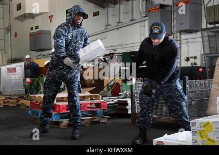 NORFOLK (Nov. 14, 2017) Air Traffic Controller Airman Kirk West (left) and Aviation Boatswainís Mate (Handling) - Stock Photo