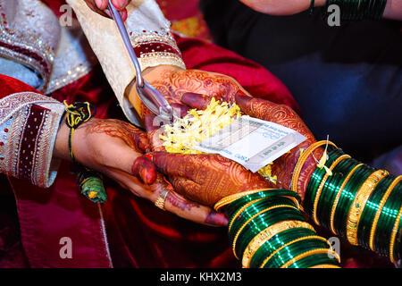 Bride And Groom At Haldi Ceremony A Couple Days Before Hindu Wedding