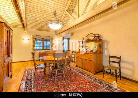 Bright, open and warm dining room with vaulted ceilings. Wonderful California home in San Diego county. Real estate - Stock Photo