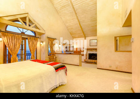 Bright, open and warm master bedroom with vaulted ceilings and a fireplace. Wonderful California home in San Diego county. Real estate listings with p