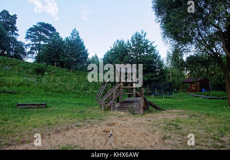 wooden children's slide in the summer in Russia Tula oblast - Stock Photo