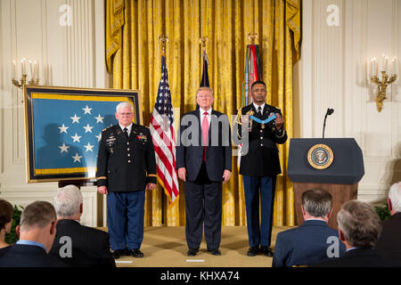 President Donald J. Trump presents the Medal of Honor to Retired Army Capt. Gary M. Rose in the East Room at the - Stock Photo