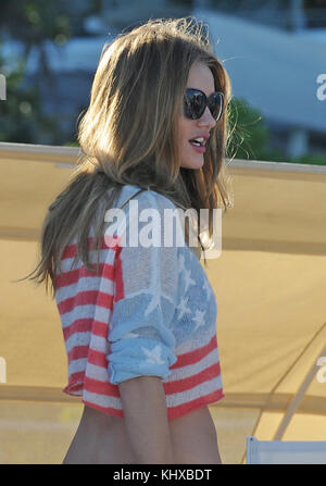 MIAMI BEACH, FL - FILE PHOTO - RED, WHITE AND BLUE  PATRIOTIC BIKINI - Relaxing in the Florida sun, Actor Jason - Stock Photo