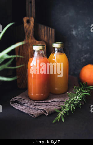 Citrus juices, detox drink, fresh raw juice in bottle. Concept of healthy lifestyle, dieting, detox and cleansing - Stock Photo