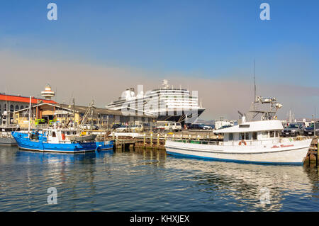 Fishing boats and the MS Oosterdam  cruise ship in the harbour of Hobart - Tasmania, Australia - Stock Photo