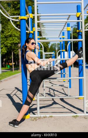 female trainer on sport playground - Stock Photo