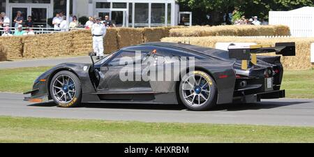 SGC 003 being driven by James Glickenhaus at the 2015 Goodwood Festival of Speed. This car was banned from the Nurburgring - Stock Photo