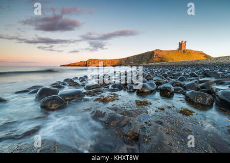Dunstanburgh Castle looking from the North, the tide had been receading and was the perfect opportunity to take - Stock Photo