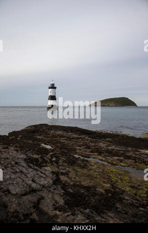 Penmon lighthouse, Trwyn Du Lighthouse between Black Point near Penmon and Ynys Seriol, or Puffin Island, at the - Stock Photo
