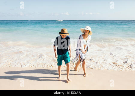 Mother and son walking on beach - Stock Photo