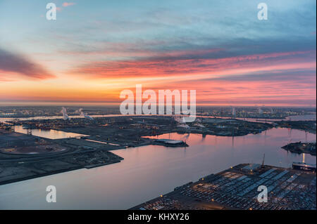 Aerial view on Port of Antwerp before sunrise with Kieldrecht sluis and Ico Terminal in the foreground - Stock Photo