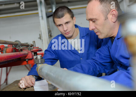 manager and worker in factory storeroom - Stock Photo