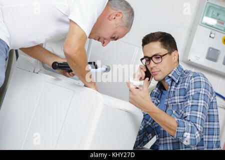 machine mechanics fixing machine - Stock Photo