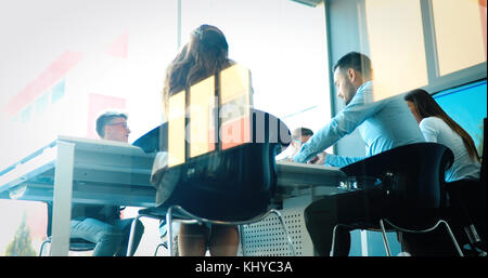 Business people conference in modern meeting room - Stock Photo