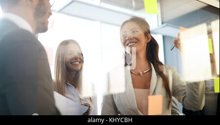 Creative business people working on business project in office - Stock Photo
